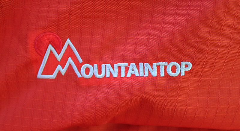 Mountaintop logo sewn on a backpack