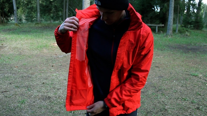 A fleece jacket worn underneath the North Face Resolve 2 rain jacket