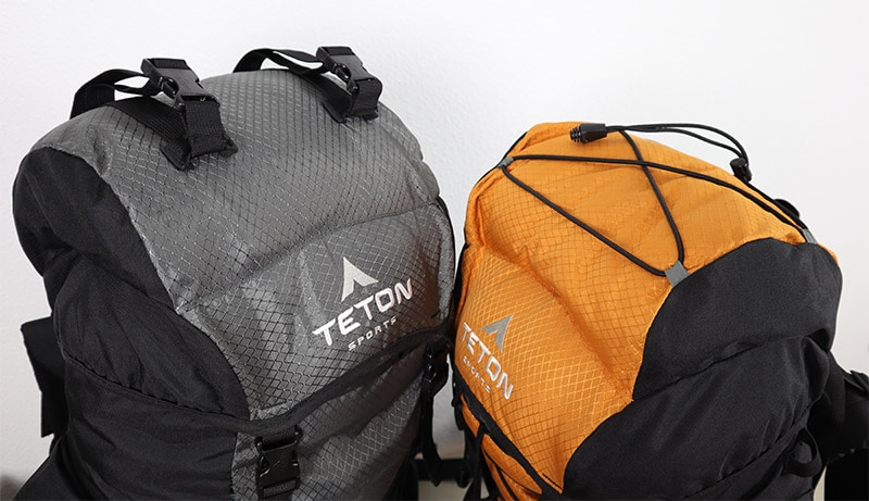 Showing the drawstrings and the buckle straps on top of both Teton Sports backpacks