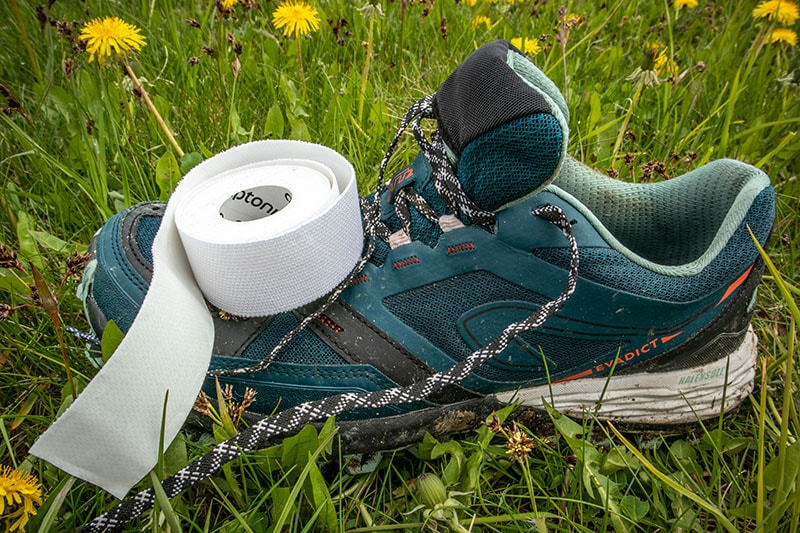 Trail runners with leuko tape on top